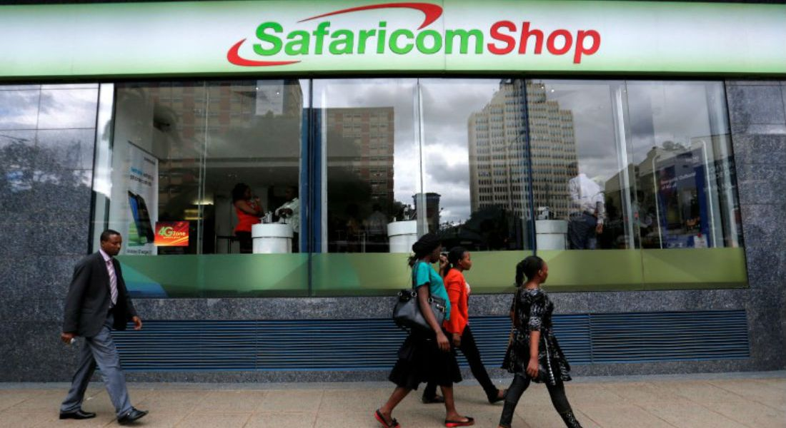 This is phot shows Pedestrians walk past a mobile phone care centre operated by Kenyan's telecom operator Safaricom in the central business district of Kenya's capital Nairobi, May 11, 2016.