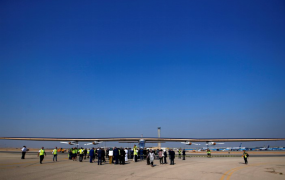 This is a photo of Solar Impulse 2, a solar powered plane, is surrounded by journalists and media after its landing at Cairo Airport, Egypt July 13, 2016.