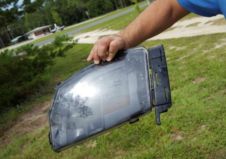 This is a photo of Robert VanKavelaar shows a piece of the Tesla found in his property where the Tesla came to rest when its driver was killed in a collision with a truck in May in Williston, Florida, U.S. July 1, 2016.