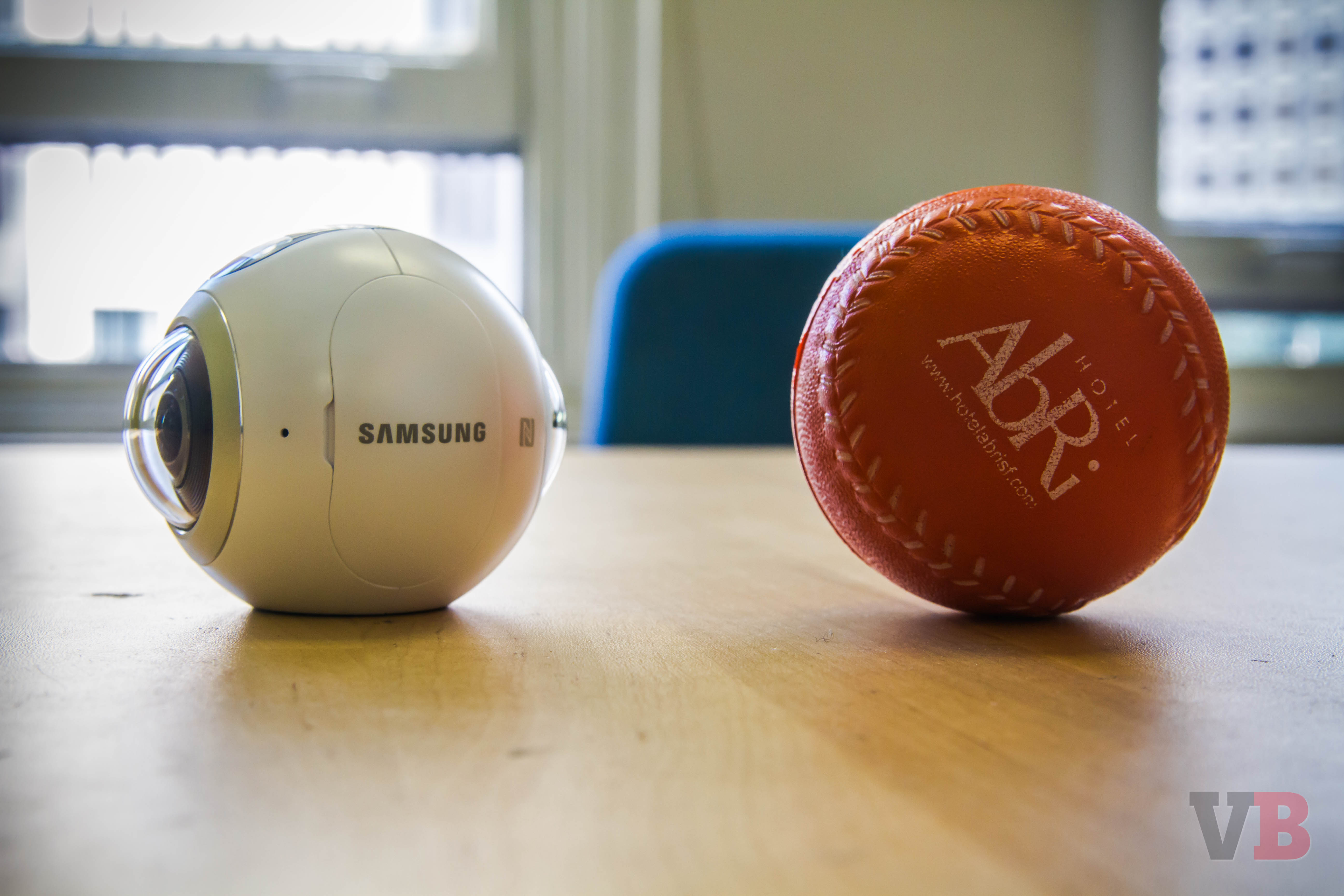 Comparing the size of the Samsung Gear 360 with a ball.
