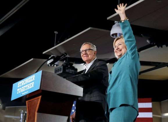 This photo shows Democratic U.S. presidential nominee Hillary Clinton waves after being introduced by Senate Minority Leader Harry Reid (D-NV) during a rally at the International Brotherhood of Electrical Workers (IBEW), Local 357, union hall in Las Vegas, Nevada, U.S. Thursday, August 4, 2016.