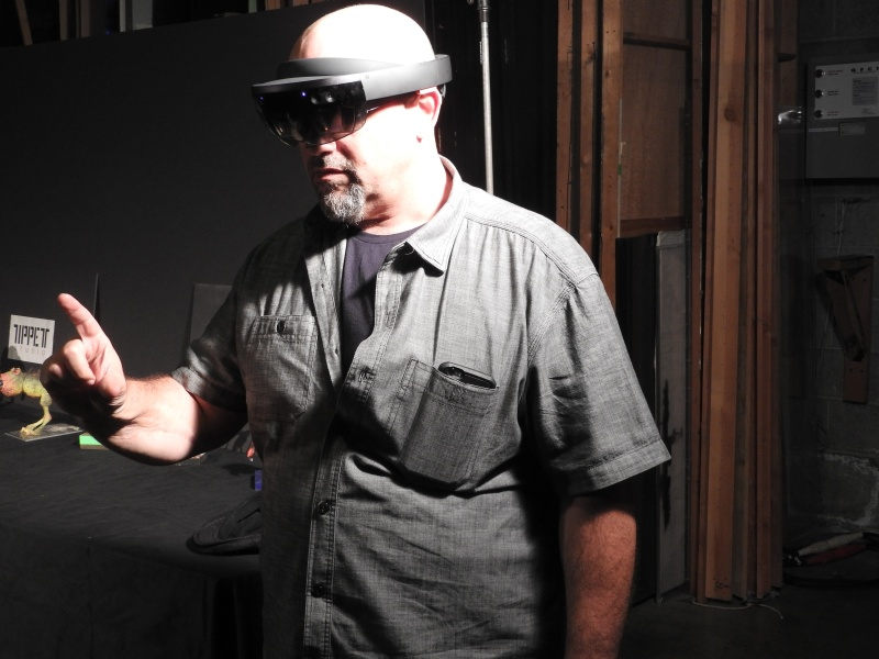 Michael Levine, president of HappyGiant, shows HoloGrid: Monster Battle on Microsoft's HoloLens.