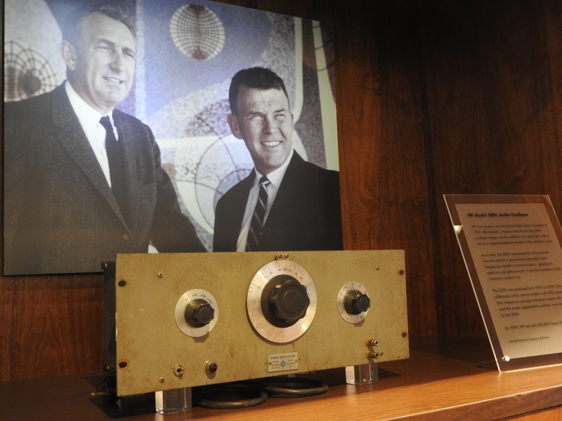 Dave Packard and Bill Hewlett with their first product at HP: the oscillator used in Disney's Fantasia.