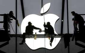 This photo shows workers prepare for the opening of an Apple store in Hangzhou, Zhejiang province, January 23, 2015.