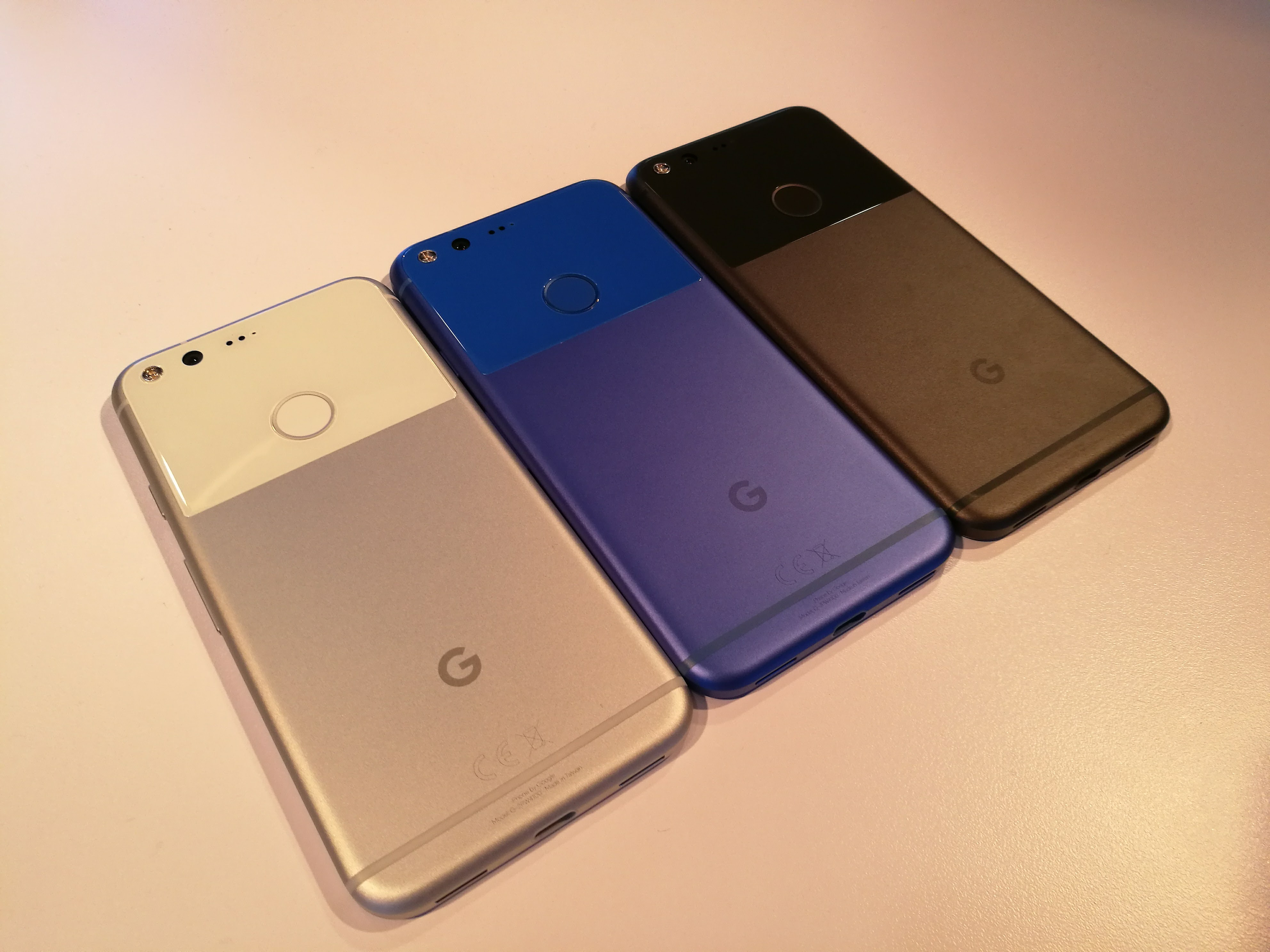 Google Pixel in Very Silver, Quite Black, and Really Blue.