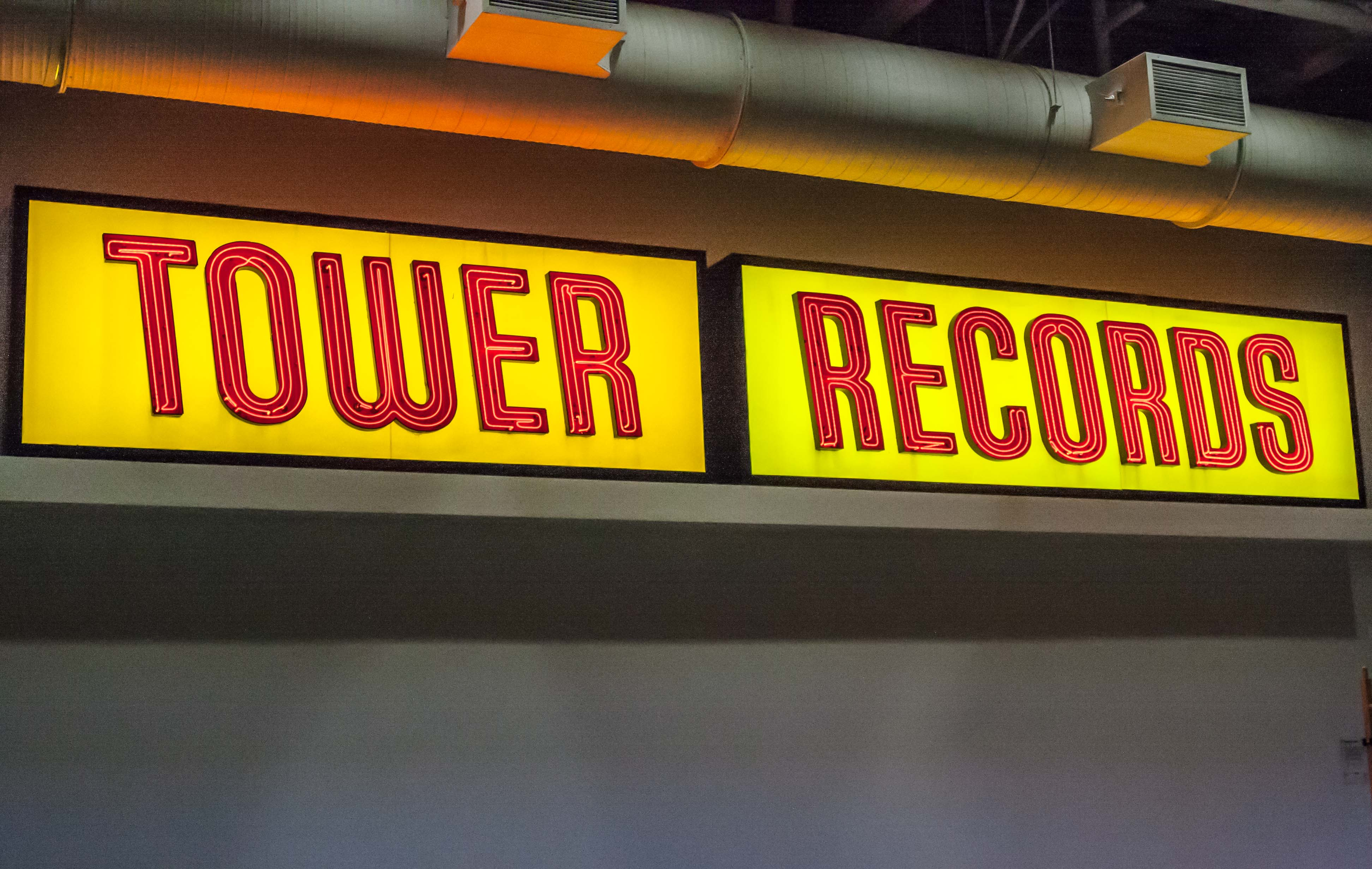 The original signage of Tower Records now hangs in the concourse of The Golden 1 Center, home of the Sacramento Kings.