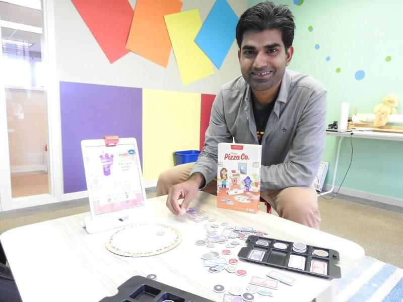 Pramod Sharma, CEO of Osmo, shows off Osmo Pizza Co.