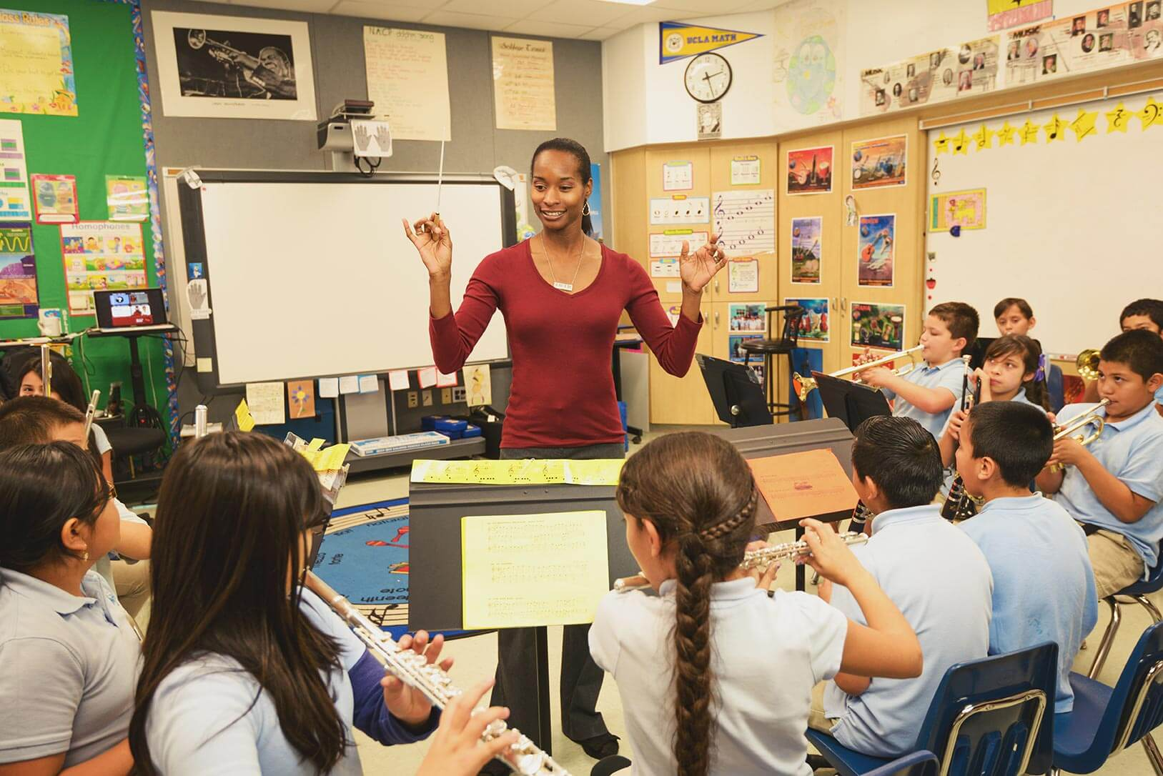 New Academy Elementary School teacher Genuine Letford leads students in her music class.
