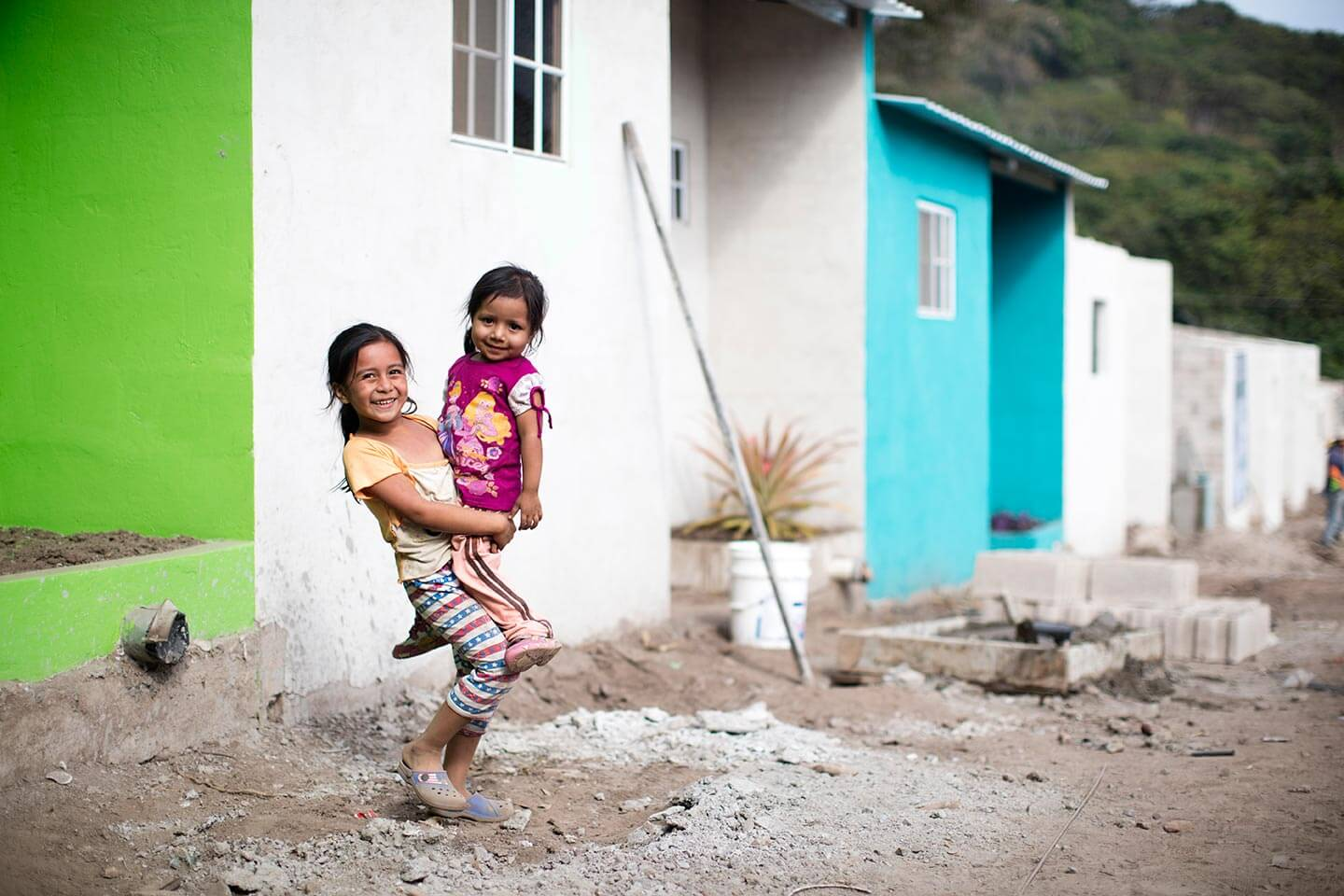 A family celebrates their new home in El Salvador.