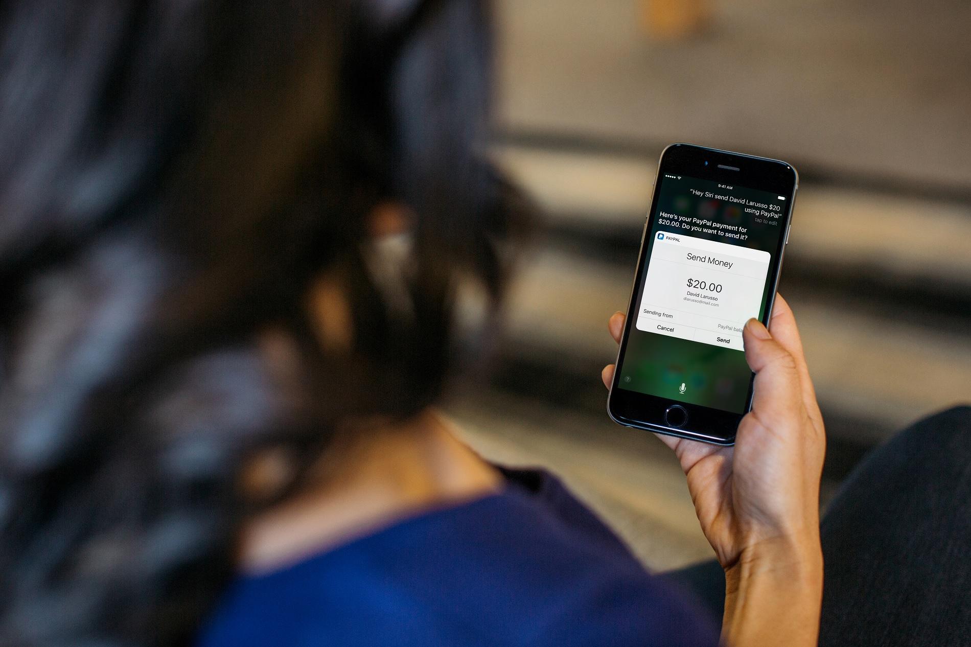 Telling Siri to send money through PayPal.