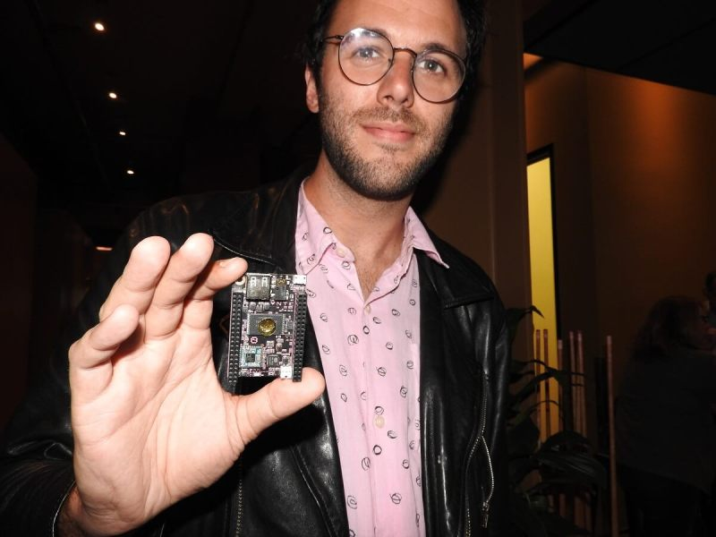 Dave Rauchwerk, CEO of Next Thing Co., holds a $9 CHIP computer.