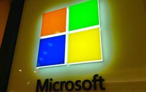 A glowing Microsoft logo at the Microsoft store