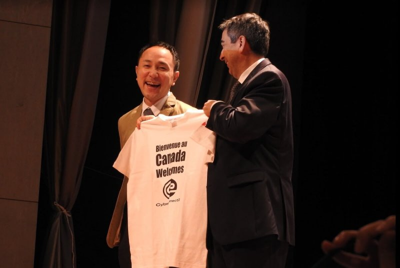 Hiroshi Matsuyama (left) of CyberConnect2 with Martial Pagé, Minister and Deputy Head of Mission for Canada in Tokyo.