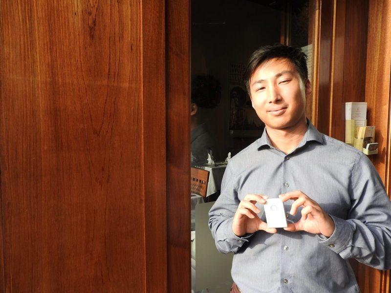 """Li """"Ricky"""" Ge shows off Healer Tech's Flexr sensor for muscle rehab."""