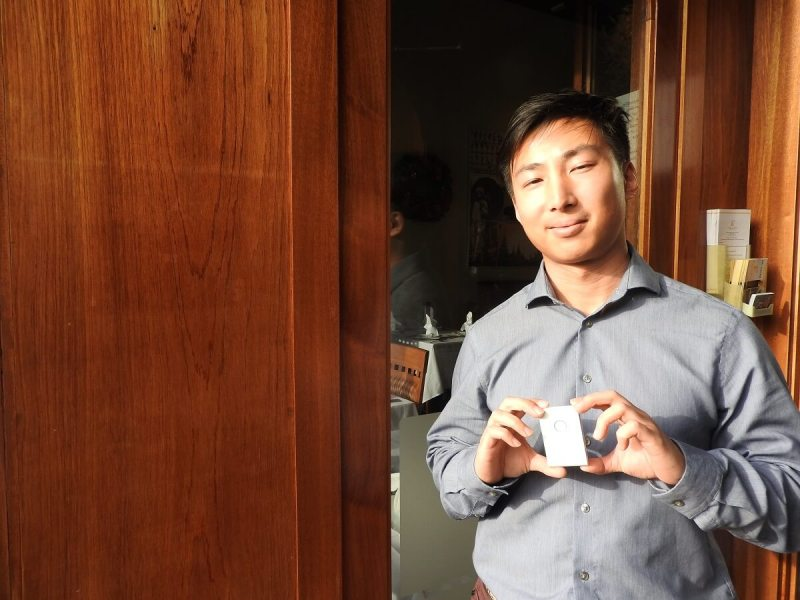 "Li ""Ricky"" Ge shows off Healer Tech's Flexr sensor for muscle rehab."