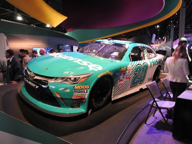 China's Hisense showed off a racing car at its booth.