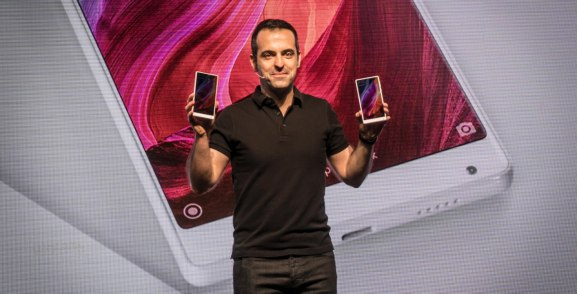 Xiaomi VP Hugo Barra holds up versions of the white Mi Mix smartphone on stage at the 2017 Consumer Electronics Show.