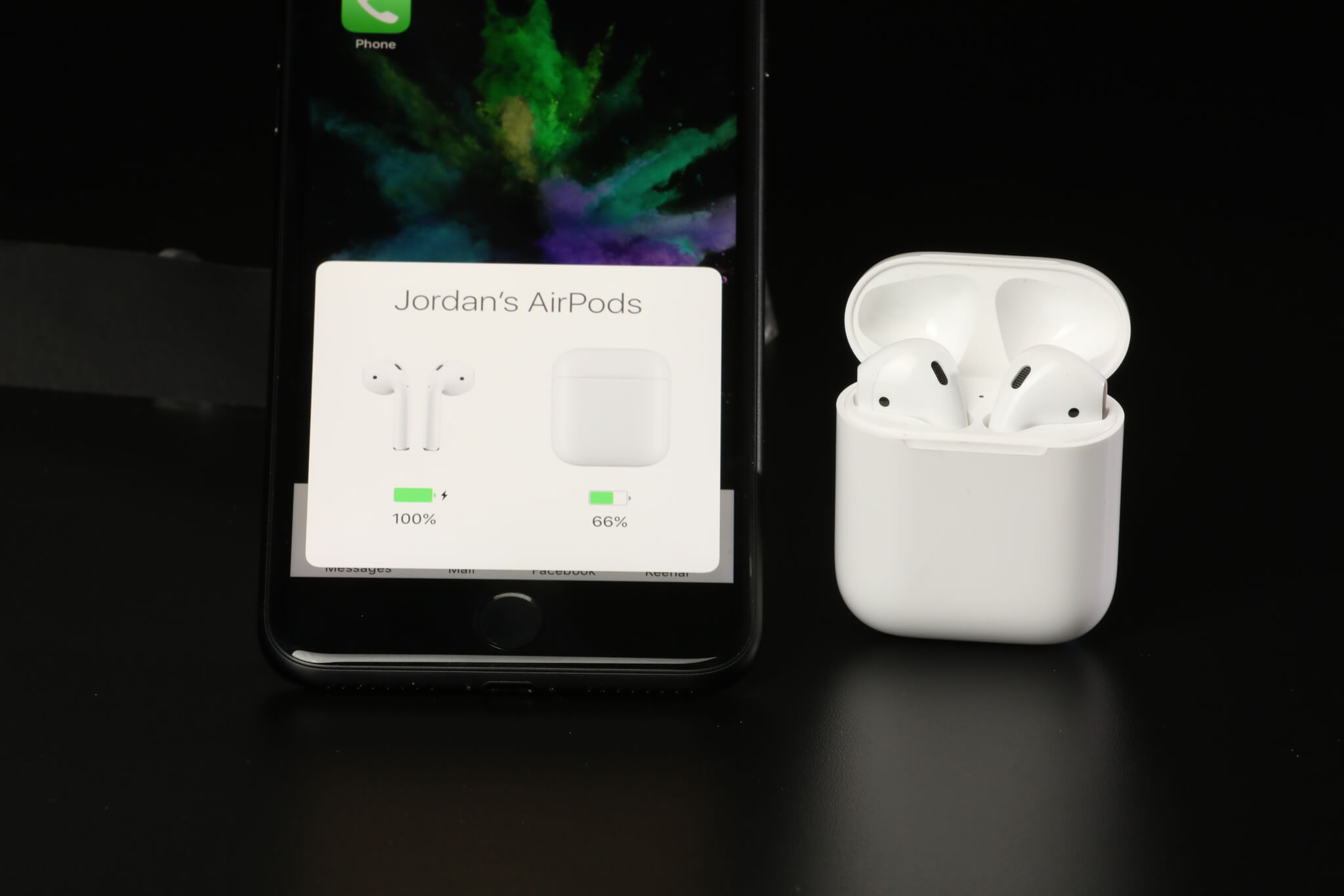 AirPods in case and the box that pops up when the case is nearby to show remaining battery life.