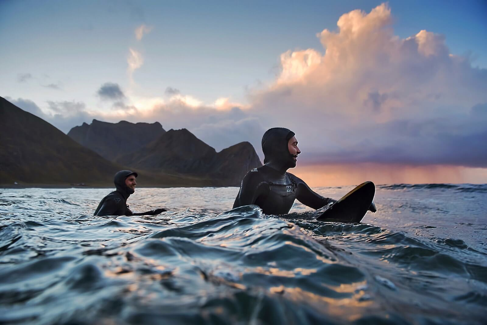This photograph of surfers on 500px is an example of one selected for licensing through Adobe Stock.
