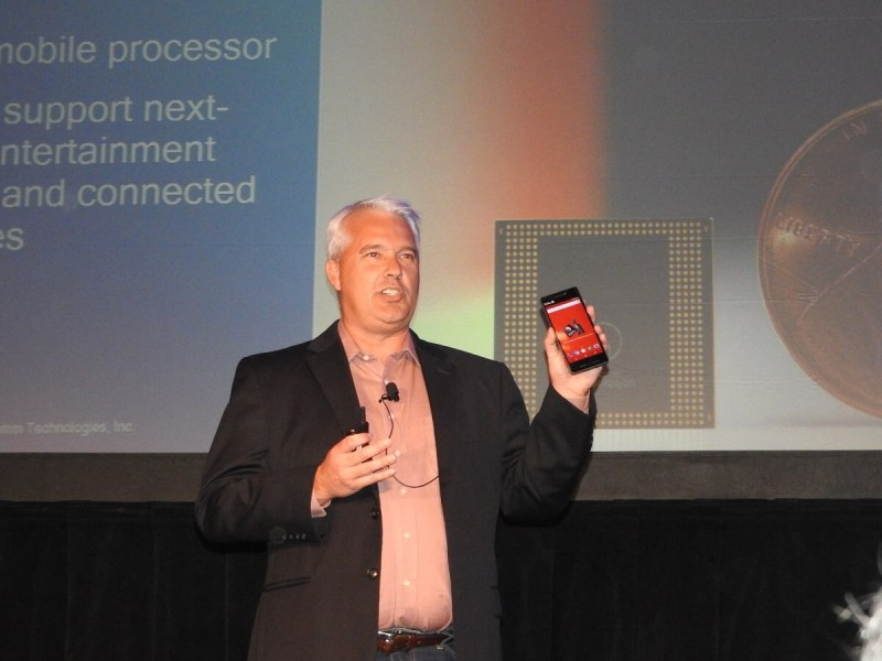 Ken Kressin of Qualcomm shows off the Snapdragon 835 chip in a reference design phone.
