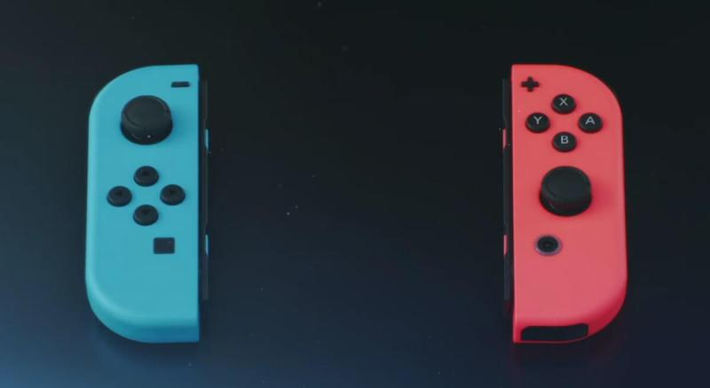 Nintendo's new Joy Con controller comes in black, blue, or red.