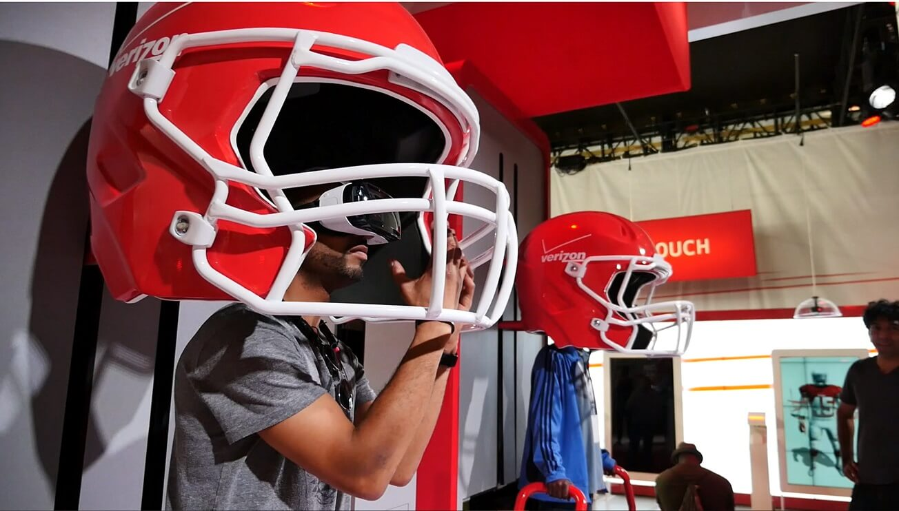 Two Bit Circus' NFL GameTime VR gave 30,000 people a feel for live action at Super Bowl XLIX by putting users in the cleats of an NFL punt returner. The custom-built oversized helmets were outfitted with surround sound, and vibrating platforms under guests' feet simulated pounding steps on the field.