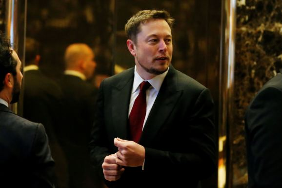 Tesla chief executive Elon Musk enters the lobby of Trump Tower in Manhattan, New York, U.S., January 6, 2017.
