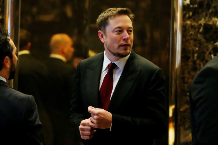 Tesla chief executive Elon Musk enters the lobby of Trump Tower in Manhattan, New York, U.S., January 6, 2017.