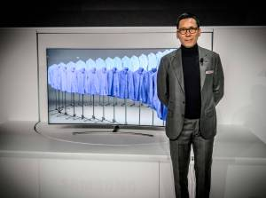 Samsung's executive vice president for its video display business, Won-Jin Lee, poses in front of the company's 2017 QLED TV during the Consumer Electronics Show.