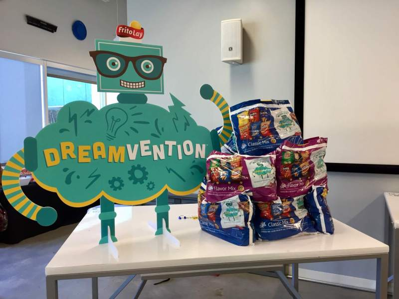 Dreamvention mascot with Frito Lay chips