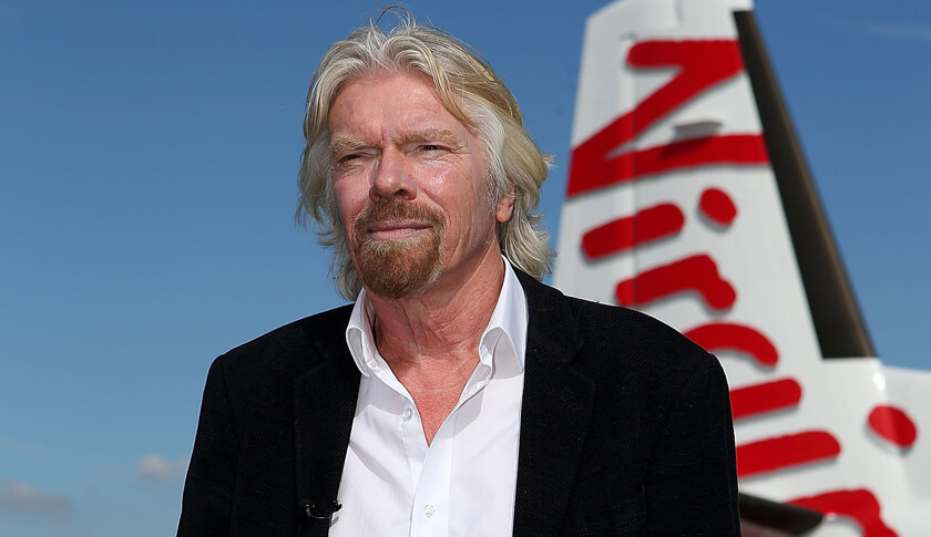 Sir Richard Branson conducts a television interview at Perth Airport on May 7, 2013 in Perth, Australia. Virgin Australia purchased Perth-based regional airline, Skywest adding another 32 planes to it's fleet to expand the airlines regional operations in Australia.