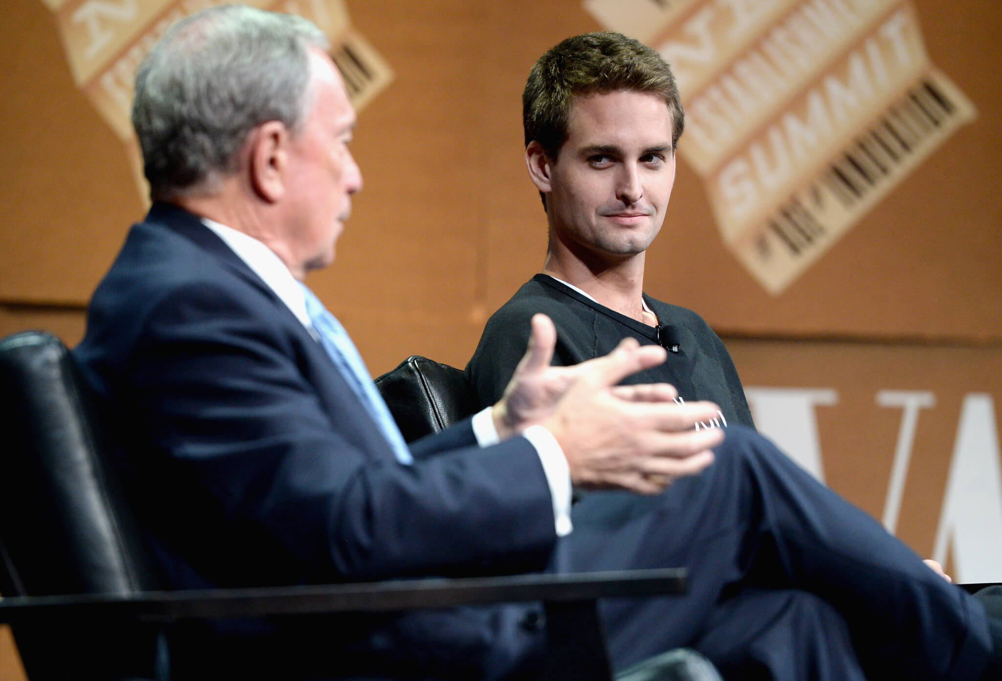 """SAN FRANCISCO, CA - OCTOBER 08: Bloomberg LP Founder Michael Bloomberg and Snapchat CEO Evan Spiegel speak onstage during """"Disrupting Information and Communication"""" at the Vanity Fair New Establishment Summit at Yerba Buena Center for the Arts on October 8, 2014 in San Francisco, California."""