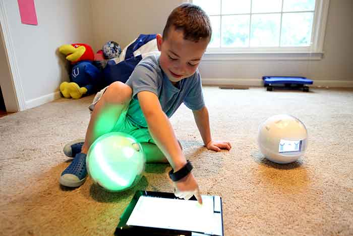 Leka's unique spherical design allow the robot to be safely handled and engage in unique play with special needs children. Image Credit: Leka, Inc / Ladislas de Toldi.