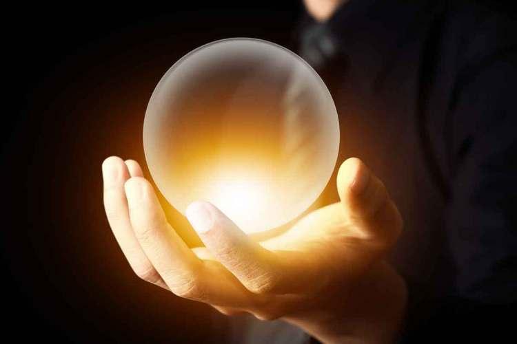 https://www.shutterstock.com/image-photo/businessman-hand-holding-crystal-ball-145689659