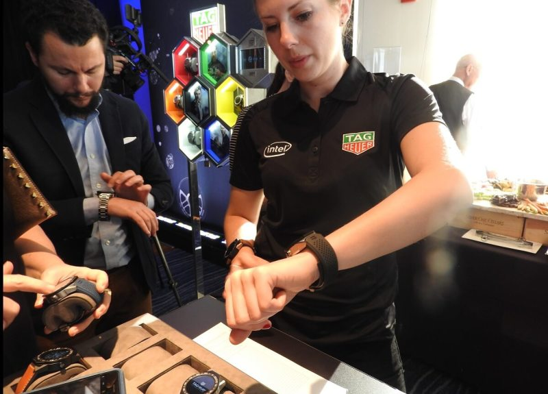 A Tag Heuer employee shows off an Intel based smartwatch.