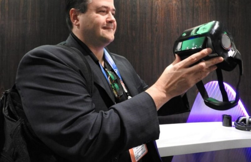 Tim Leland of Qualcomm's shows off wireless VR headset.