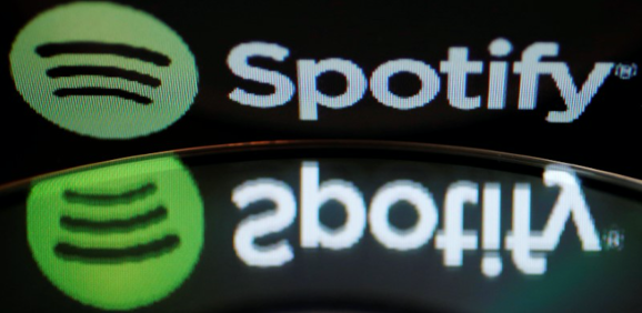 The Spotify logo reflected in a music CD.