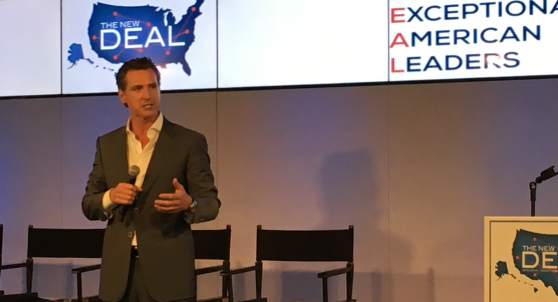 This is a photo of Lieutenant Governor Gavin Newsom onstage at The New Deal Ideas Summit on May 30, 2017.