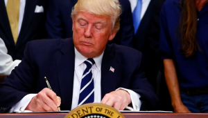 """This photo shows U.S. President Donald J. Trump as he delivers remarks on """"Apprenticeship and Workforce of Tomorrow"""" initiatives and signs an executive order at the White House in Washington, U.S. June 15, 2017."""