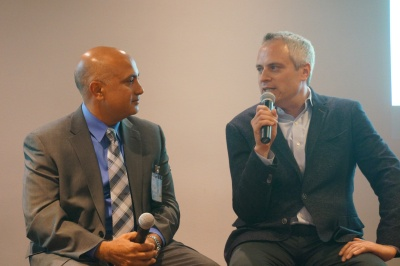 Tech jobs needed how to bridge skills and opportunity gaps in a photo shows brad stone and vish makhijani speaking with one another malvernweather Image collections