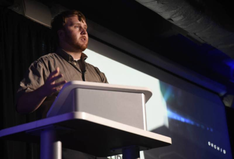 This image shows Collider Tech CEO Graham Bredemeyer onstage at Gigtank365's Pitch Night on Wednesday, July 27, 2016 at the Edney Innovation Center in Chattanooga, TN.