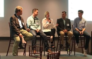 This photo shows VentureBeat's Blaise Zerega, Bombora's Rob Armstrong, Capstak's. Heather Goldman, EDAWN's Mike Kazmierski, and TrainerRoad's Nate Pearson onstage at the VentureBeat Heartland Tech and Blueprint kickoff event in San Francisco on June 14, 2017.