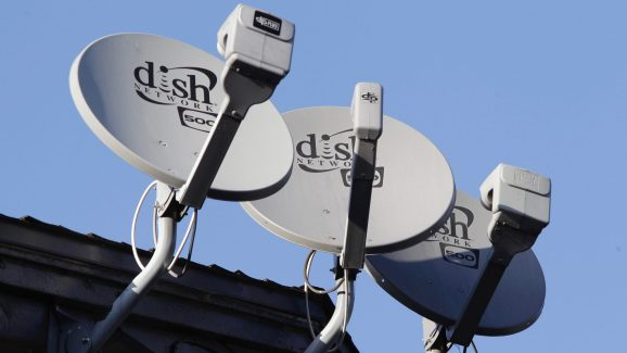 Three Dish Network satellite dishes are shown at an apartment complex in Palo Alto, Calif., Wednesday, Feb. 23, 2011. Dish Network, the nation's third-largest provider of pay-TV service, is reporting that its fourth-quarter net income rose 41 percent to beat Wall Street analysts' expectations, even as it lost subscribers.