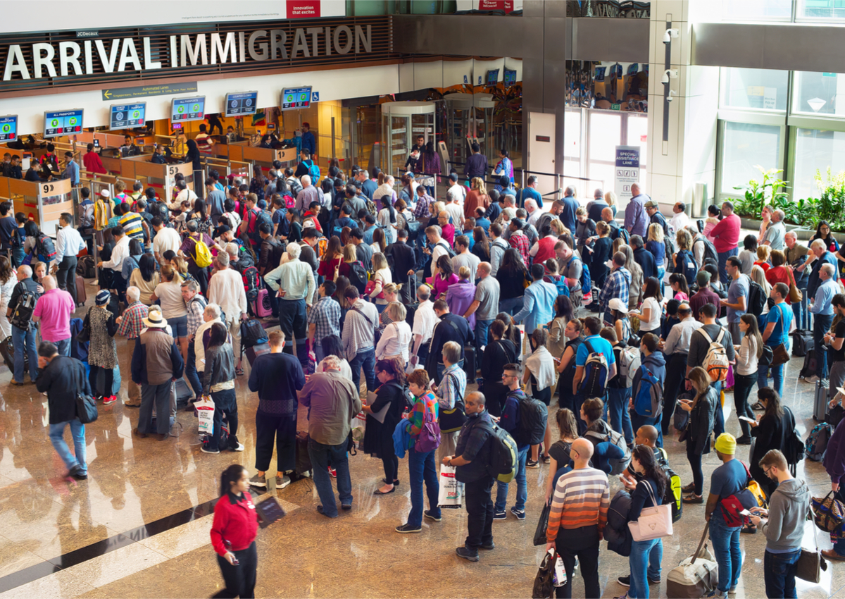 Above People waiting in queue at arrival immigration of Singapore's Changi airport Image Credit joyfull  Shutterstock
