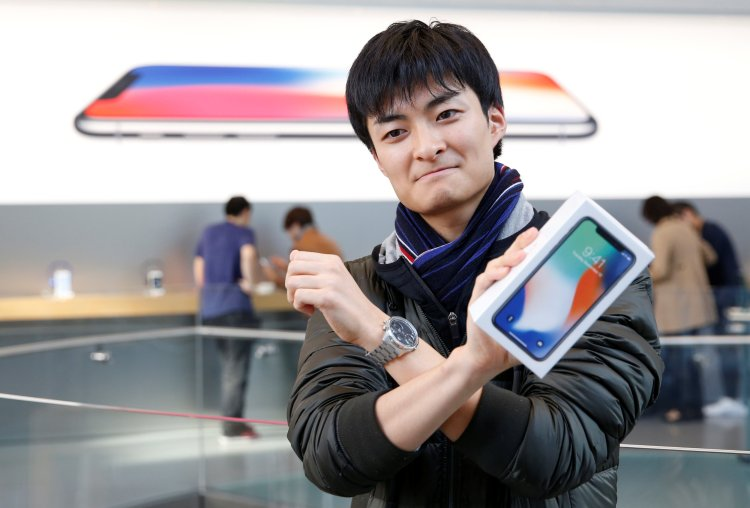 First buyer Yamaura holds Apple's new iPhone X.