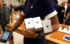 An Apple Store staff shows Apple's new iPhones X after they go on sale at the Apple Store in Regents Street, London, Britain, November 3, 2017.