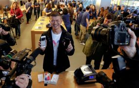 The first customer shows his new iPhone X after buying it at an Apple Store in Beijing, China November 3, 2017.