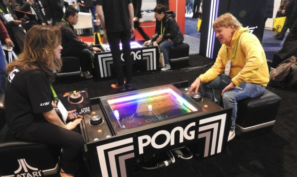 photo image Atari Table Pong cleverly re-creates the classic video game using physics