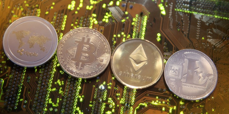 Representations of the Ripple, Bitcoin, Ethereum, and Litecoin cryptocurrencies.