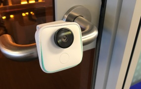 Google's Clips camera clipped onto a door handle.